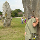 Peter testing for sound quality on one of Avebury standing stones during the day out there with members of SDG