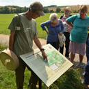 Peter points out Silbury Hill on the map en-route to West Kennet Long Barrow