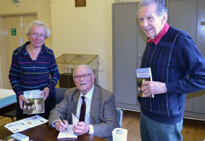 Peter Golding signs his memoir